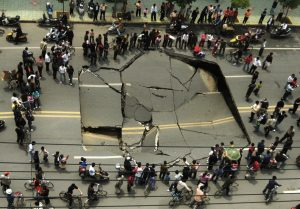 People look at a collapsed section of Shunwai Road in Nanchang